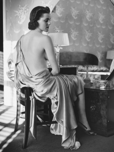 george-marks-woman-in-silk-bathrobe-sitting-in-front-of-vanity-table